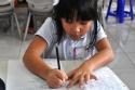 Ananda belajar menulis surat, kali ini kepada orang tuanya.